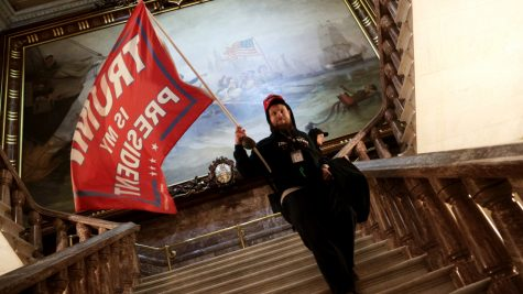 WASHINGTON, DC - JANUARY 06: A protester holds a Trump flag inside the US Capitol Building near the Senate Chamber on January 06, 2021 in Washington, DC. Congress held a joint session that day to ratify President-elect Joe Biden