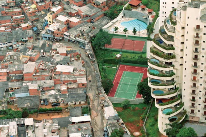 Picture taken by photographer Tuca Vieira in Brazil (2004). This contrasts the poverty of Paraisópolis favela (left) with its wealthy neighbor, Morumbi (right).