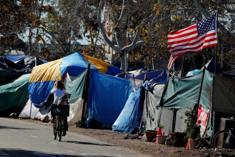 City officials have begun what they are calling a slow and methodical clean-up and removal of a large homeless encampment along the Santa Ana River Trail in Anaheim, California, U.S., January 22, 2018.      REUTERS/Mike Blake - RC113659B920